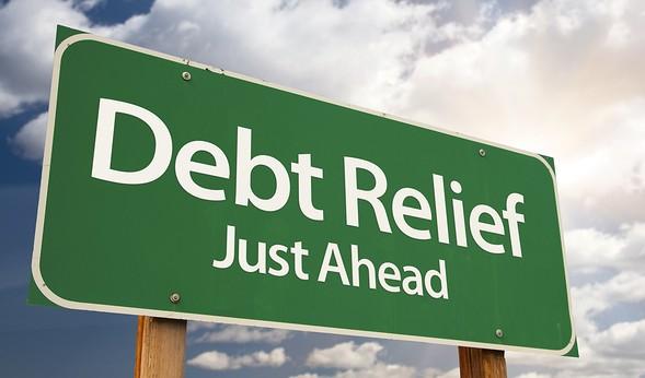 bigstock-Debt-Relief-Just-Ahead-Green-22963049-e1368042855375